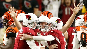 Arizona Cardinals Chandler Catanzaro (left) celebrates after kicking the game-winning field goal against the Cincinnati Bengals in the fourth quarter on Nov. 22, 2015, in Glendale.
