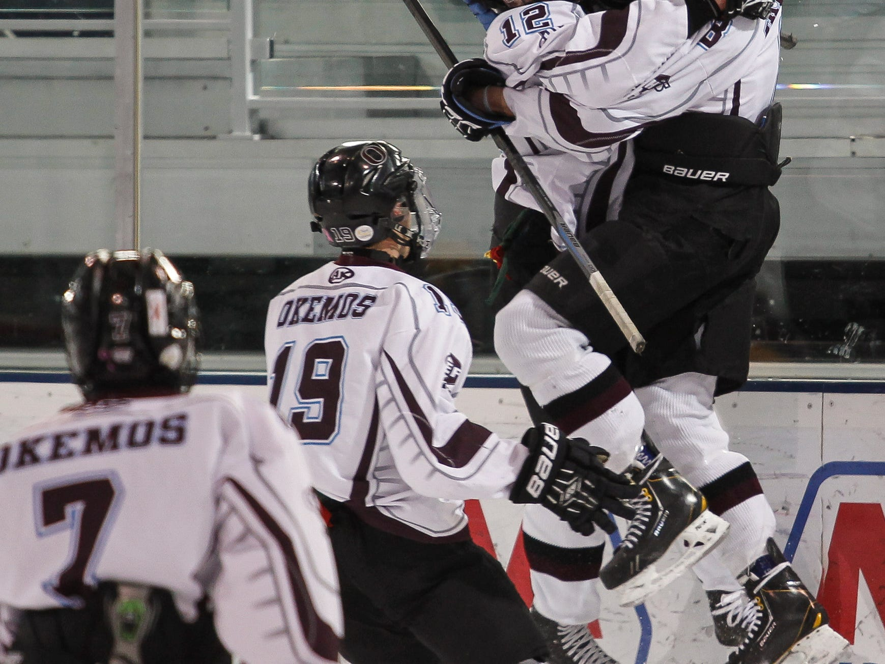 Okemos' Jake Faustyn, right, celebrates a goal with teammates during the Division 3 quarterfinals last month.