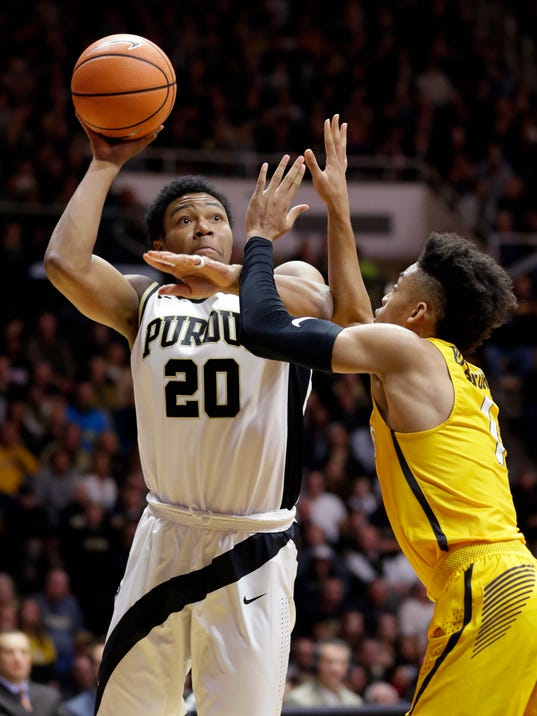 Purdue guard Nojel Eastern (20) shoots over Valparaiso guard Micah Bradford (1) during the second half of an NCAA college basketball game in West Lafayette, Ind., Thursday, Dec. 7, 2017. (AP Photo/Michael Conroy)
