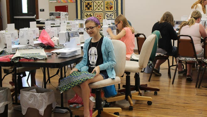 Josie Resh, left, and Jordyn Nace are sewing bags on Bernina350s at Danner's BerninaShoppe Sew Camp.
