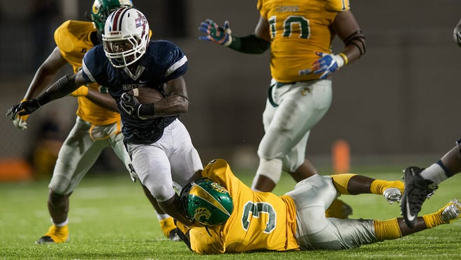 Park Crossing's Uziah McDaniels is tripped up by Carver's Jacques Murphy (3) at Cramton Bowl in Montgomery, Ala. on Friday October 6, 2017.