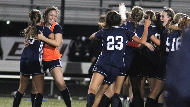 Notre Dame players celebrate their state semifinal win.