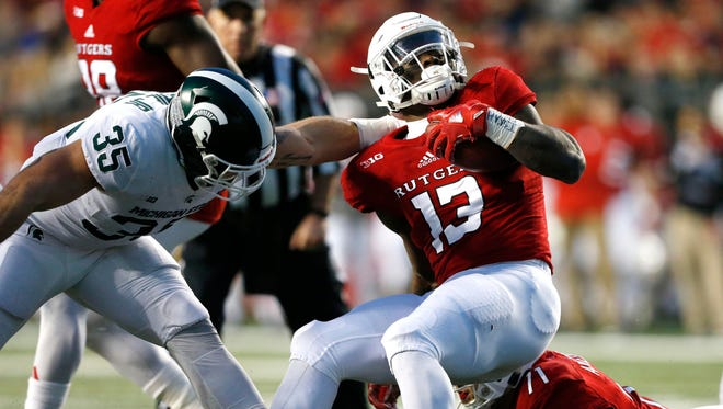 Nov 25, 2017; Piscataway, NJ, USA; Rutgers Scarlet Knights running back Gus Edwards (13) is stopped by Michigan State Spartans linebacker Joe Bachie (35) during first half at High Point Solutions Stadium.
