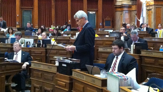 Iowa state Rep. Kevin Koester, R-Ankeny, answers a question on legislation prohibiting confidentiality agreements in employee settlements during floor debate on Monday.