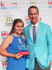 Peyton Manning poses with Regional Softball Player