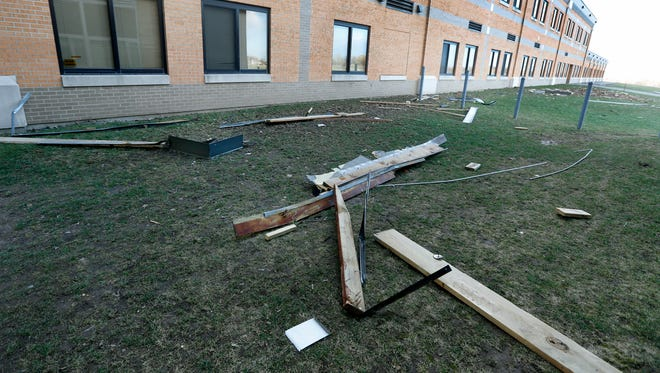 Debris from the roof of Greece Arcadia Middle School due to the strong winds.