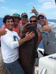 Alex Newman, far right, and fishing crew with the 124.15-pound