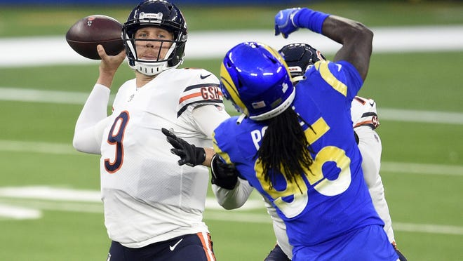 Chicago Bears quarterback Nick Foles (9) throws against the Los Angeles Rams during the first half of Monday's game, in Inglewood, Calif.