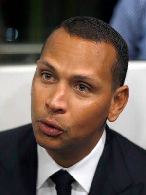 """Alex Rodriguez speaks during a Jan. 16, 2014, news conference in Cancun, Mexico. Rodriguez issued a handwritten apology """"for the mistakes that led to my suspension"""" but has turned down New York's offer to use Yankee Stadium for a news conference and has failed to detail any specifics about his use of performance-enhancing drugs. (AP Photo/Israel Leal, File)"""