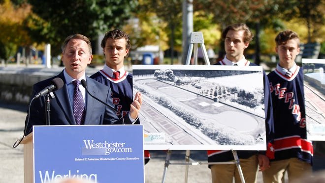 Westchester County Executive Rob Astorino flanked by Stepinac hockey players, announces the plans for an ice rink at Kensico Dam Plaza during an press conference in Valhalla on Tuesday, October 11, 2016.