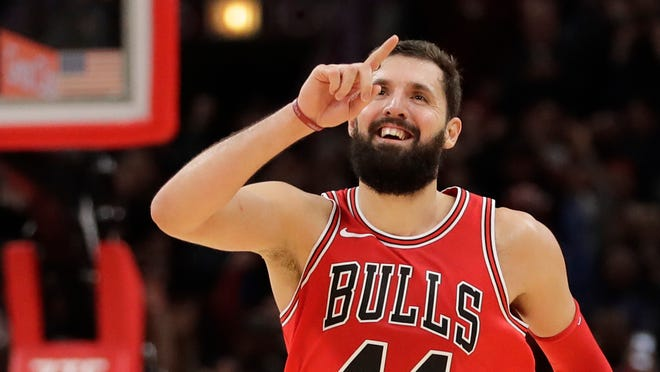 Chicago Bulls' Nikola Mirotic celebrates as his team pulls away from the Philadelphia 76ers during the second half of their game on Monday, Dec. 18, 2017, in Chicago.