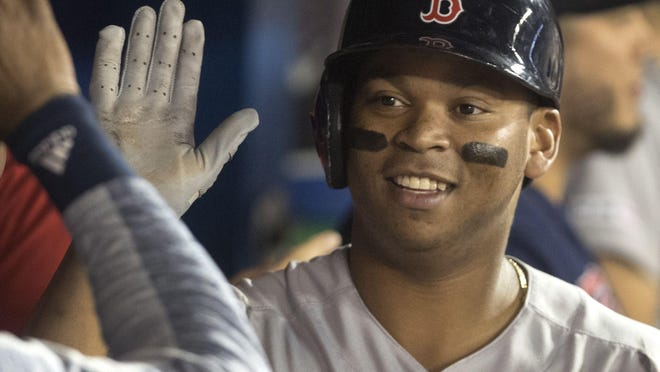 Rafael Devers was back to work at Fenway Park on Wednesday.