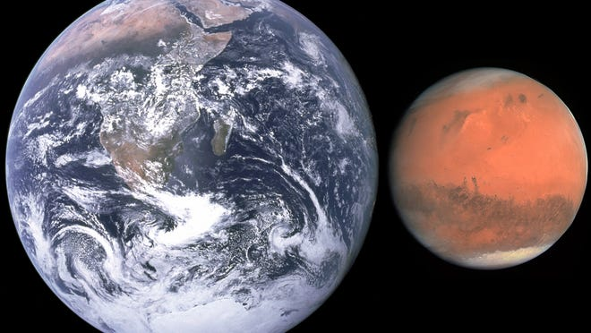 Earth and Mars are shown next to each other to compare their size. Thankfully Mars never comes this close!