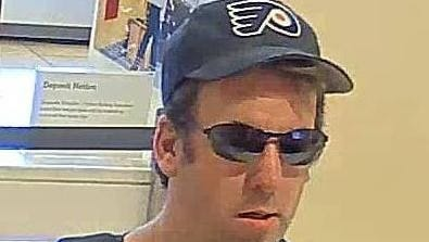 Authorities say this surveillance images shows Steven Rice of Barrington robbing a bank in Philadelphia on June 30.