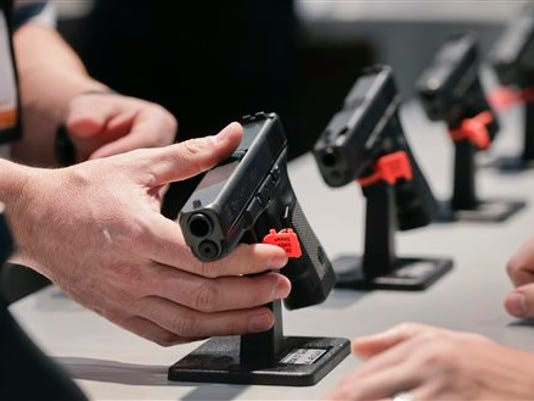 A friend recently applied for a Concealed Weapons Permit. She was asked to bring $20 and her state ID with her.  (Associated Press -- File)