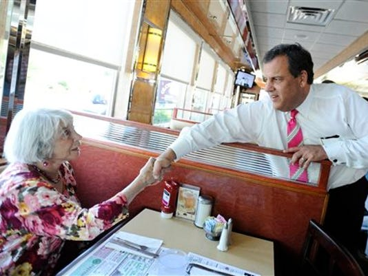 Gov. Chris Christie greets Ernestine Durrell during a visit to a diner in Greenwich, Conn., with Republican gubernatorial candidate Tom Foley on Monday. He's back on the trail today, out in Colorado. (AP Photo/Jessica Hill)