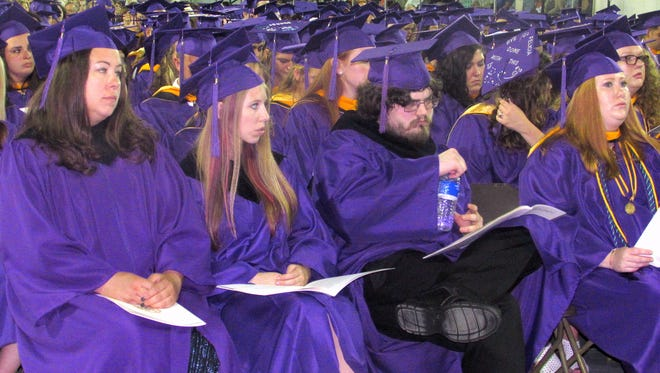 Graduating Elmira College students watch as Sunday's commencement ceremony unfolds.