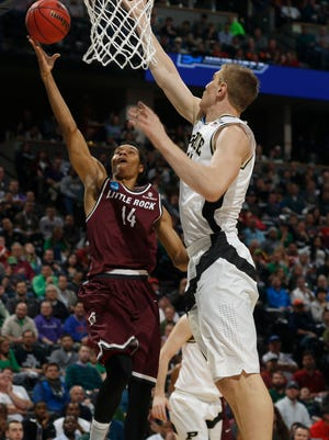 Arkansas Little Rock forward Mareik Isom, left, drives for a shot as Purdue center Isaac Haas defends in the first half of a first-round men's college basketball game Thursday, March 17, 2016, in the NCAA Tournament in Denver. (AP Photo/David Zalubowski)