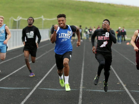 Robert E. Lee's Iyon Oravitz wins the 100 meter dash
