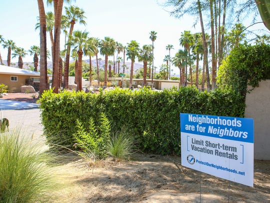 A resident's front yard sign advocates for limiting short-term vacation rentals in the Deepwell neighborhood in Palm Springs.