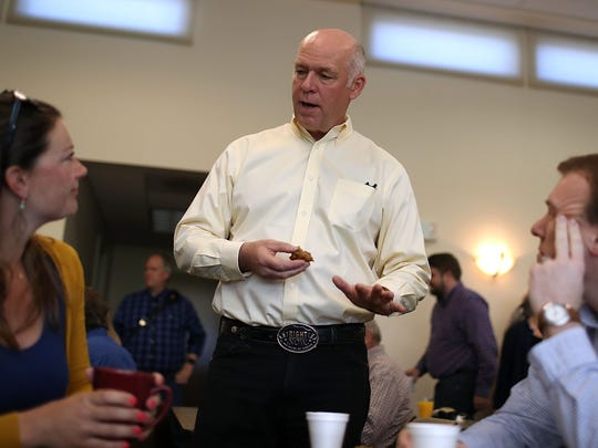 Republican congressional candidate Greg Gianforte is pictured talking with supporters during a campaign meet and greet.