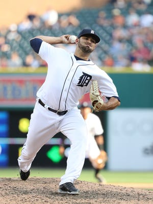 Tigers pitcher Arcenio Leon pitches during the ninth inning of the Tigers' 10-1 win Saturday at Comerica Park.
