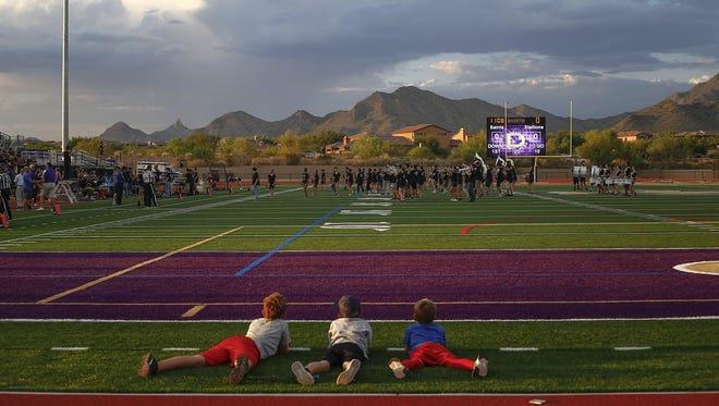 Kids lay at the end zone at Notre Dame Preparatory High School on August 19, 2016.
