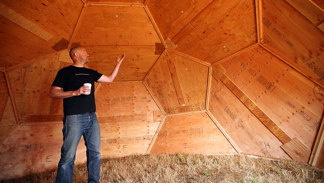 Rich Batcheller, owner of Blackmouth Design, talks about the interior construction of their geodesic dome on Bainbridge Island on Friday.