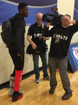 Former Michigan guard Caris LeVert, in his cast and walking boot, at the NBA combine in Chicago.