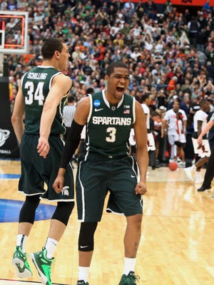 Michigan States Alvin Ellis III and Gavin Schilling celebrate the 76-70 overtime win against the Louisville Cardinals in the NCAA East Regional Final on Sunday, March 29,2015 at Carrier Dome in Syracuse N.Y.