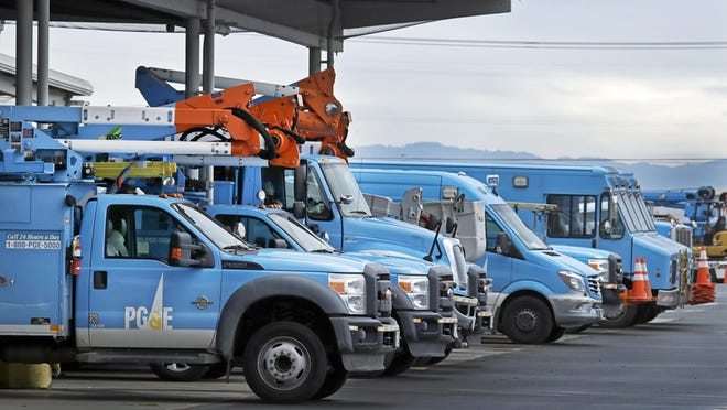 Pacific Gas & Electric vehicles are parked at the PG&E Oakland Service Center in Oakland, Calif. PG&E filed for bankruptcy protection.