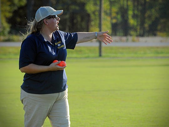 Holly Grove head field hockey coach Mandy Lankford coaches her team from the sidelines in Westover on Friday, Oct. 21, 2016.