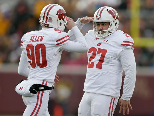 Wisconsin Badgers kicker Rafael Gaglianone (27) is saluted by teammate Badgers punter Connor Allen after kicking a field goal.