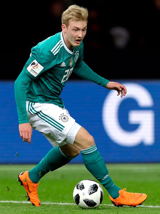 FILE - The March 27, 2018 file photo shows Germany's Julian Brandt during the international friendly soccer match between Germany and Brazil in Berlin, Germany. Bayer Leverkusen has warded off interest in Germany midfielder Julian Brandt by extending the 21-year-old's contract by two years to 2021. (AP Photo/Michael Sohn, file)