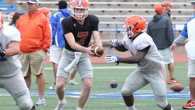 San Angelo Central High School quarterback Maverick McIvor (7) hands the ball off to a running back during spring practice at San Angelo Stadium on Wednesday, April 25, 2018. McIvor is coming off a spectacular junior season. He helped the Bobcats finish 11-1 and win an unprecedented fifth straight district title.