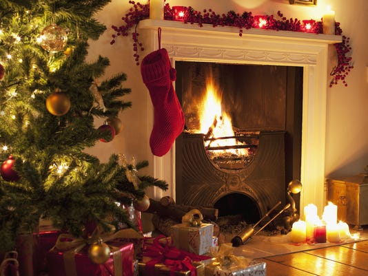 christmas tree and stocking near fireplace - When Should I Start Decorating For Christmas