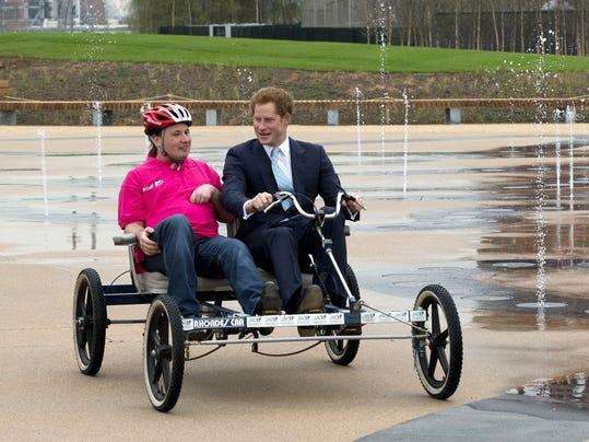 Prince Harry rides quadricycle