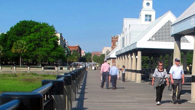 This April 23, 2015 photograph shows visitors walking along the pier at the Waterfront Park in Charleston, S.C. Figures released by the South Carolina Department of Parks, Recreation and Tourism show that, through the first half of 2015, its been another good year for South Carolina's $18 billion tourism industry. (AP Photo/Bruce Smith)
