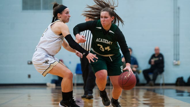 St. Johnsbury's Josie Choiniere (34) drives to the hoop past Essex's Rachel Botala (42) during the girls basketball game between the St. Johnsbury Hilltoppers and the Essex Hornets at Essex High School on Monday night