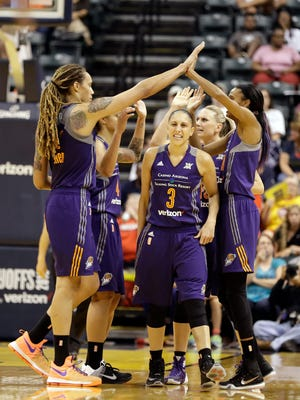 Phoenix Mercury's Diana Taurasi (3) walks to the bench as teammates celebrate after a timeout by the Indiana Fever during the second half of a first round WNBA playoff basketball game, Wednesday, Sept. 21, 2016, in Indianapolis. Phoenix won the game, 89-78.