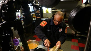 Capt. David Odom coats pie crust for a sweet potato pie on Thursday, March 16, 2017 at Lansing Fire Station 6. The Lansing Fire Department has started doing videos of some of the meals they cook at the fire house.