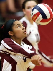 De Pere's Kasheah Jennings bumps up a spike against Green Bay Notre Dame on Sept. 22 in a FRCC match. Jennings is one of nine seniors on the team for the Redbirds.