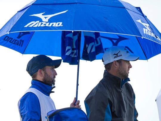 Drew Fair, left, caddies for his twin brother, Seth Fair, at the Web.com United Leasing & Finance Championship at the Victoria National Golf Club Friday morning. Seth Fair's older brother, Nate, also caddies for his brother, but was happy to be watching from the sidelines on this rainy day.