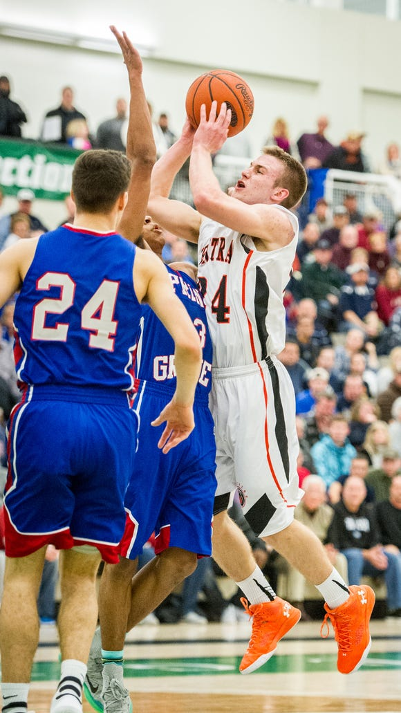 Central York's Jared Wagner (24) drives to the basket
