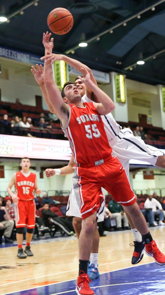 Somers' Max Germaine (55) fights for a rebound during