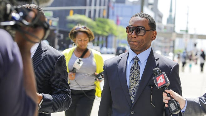 Derrick Miller, ex-Detroit Mayor Kwame Kilpatrick's right-hand man, leaves the courthouse after being sentenced on Thursday, May 28, 2014 in Detroit.