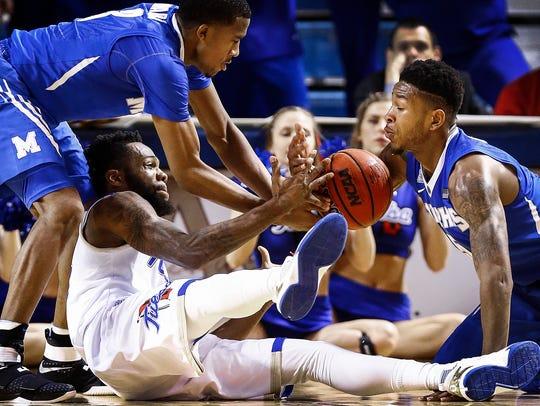 University of Memphis teammates Jeremiah Martin (left)