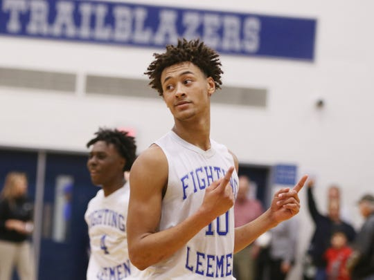 R.E. Lee's Jarvis Vaughan celebrates in the final seconds of the Leemen's 62-58 victory over Central-Woodstock in their VHSL Class 2 boys basketball semifinal game on Tuesday, March 6, 2018, at Spotswood High School in Penn Laird, Va. The Leemen advanced to Friday's state final in Richmond and will face Gate City.