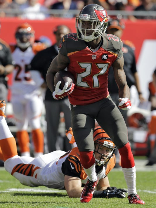 Tampa Bay Buccaneers cornerback Johnthan Banks (27) eludes Cincinnati Bengals tight end Ryan Hewitt (89) after intercepting a pass by quarterback Andy Dalton during the first quarter of an NFL football game Sunday, Nov. 30, 2014, in Tampa, Fla. (AP Photo/Chris O'Meara)