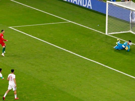 APTOPIX_Russia_Soccer_WCup_Iran_Portugal_72651.jpg